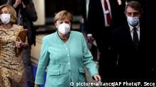 German Chancellor Angela Merkel, center, and European Parliament President David Sassoli, right, wear face masks, to protect against the coronavirus, as they arrive at the European Parliament in Brussels, Wednesday, July 8, 2020. Germany has just taken over the European Union's rotating presidency, and must chaperone the 27-nation bloc through a period of deep crisis for the next six months and try to limit the economic damage inflicted by the coronavirus. (AP Photo/Francisco Seco) |