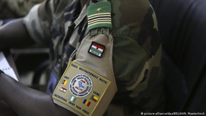 A soldier has the logo of the MNJTF Multinational Joint Task Force sewn on his uniform sleeve