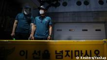 South Korean policemen stand guard in front of Seoul Mayor Park Won-soon's residence in Seoul, South Korea, July 9, 2020. Yonhap via REUTERS ATTENTION EDITORS - THIS IMAGE HAS BEEN SUPPLIED BY A THIRD PARTY. SOUTH KOREA OUT. NO RESALES. NO ARCHIVE.
