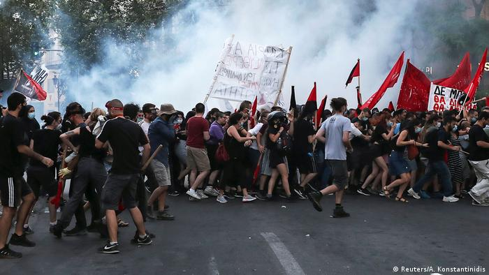 Greece: Violence as thousands march against protest law | News ...