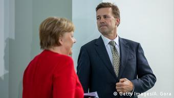 Штеффен Зайберт и Ангела Меркель