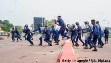 9.7.2020, Kinshasa, DR Kongo, Police officers clash with demonstrators in Kinshasa on July 9, 2020 in demonstrations organized against the presidential party Union for Democracy and Social Progress (UDPS) for the appointment of the new president of the Electoral Commission. - The Democratic Republic of Congo is going through a period of high political tension. (Photo by Arsene Mpiana / AFP) (Photo by ARSENE MPIANA/AFP via Getty Images)