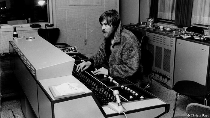 Conny Plank sits at the faders, clad in a fur coat (Christa Fast)