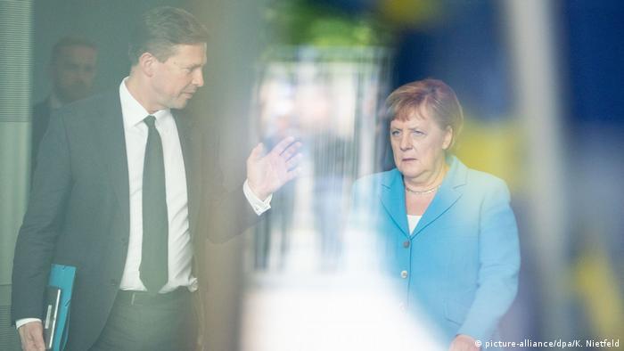 Ангела Меркель и Штеффен Зайберт
