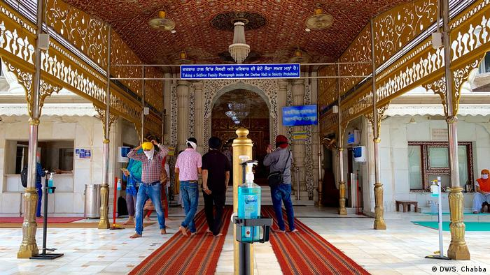 Last month, religious places reopened across India. As the public returned, preventive measures like temperature checks, hand sanitizers, and masks were implemented.