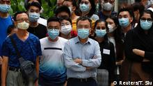 10.07.2020 People wear surgical masks to prevent the spread of the coronavirus disease (COVID-19), in Hong Kong, China July 10, 2020. REUTERS/Tyrone Siu