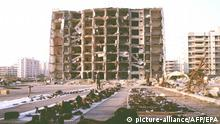 US and Saudi officials spread debris 29 June on plastic sheets as they continue to gather evidence in the 25 June bombing outside the Khobar Towers complex in Dhahran, Saudi Arabia. The explosion killed 19 and injured some 260. COLORplus  
