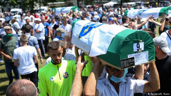 Coffins being carried