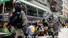 July 1, 2020, Hong Kong, China: Riot police officers arresting protesters during the demonstration..Following the passing of the National Security Law that would tighten on freedom of expression, Hong Kong protesters marched on the streets to demonstrate. Protesters chanted slogans, sang songs, and obstructed roads. Later, riot police officers arrested several protesters using paintballs and pepper spray. (Credit Image: © Willie Siawillie Siau/SOPA Images via ZUMA Wire |