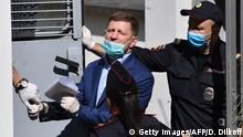 Russia's Khabarovsk region governor Sergei Furgal is escorted into a police van after a court hearing in Moscow on July 10, 2020. - A Moscow court on July 10 ordered the governor of a Far Eastern region held for two months ahead of his trial on murder charges that sparked outrage from his party. The head of Khabarovsk, Sergei Furgal, 50, was arrested on July 9 on suspicion of ordering the murder of several businessmen 15 years ago. (Photo by Dimitar DILKOFF / AFP) (Photo by DIMITAR DILKOFF/AFP via Getty Images)