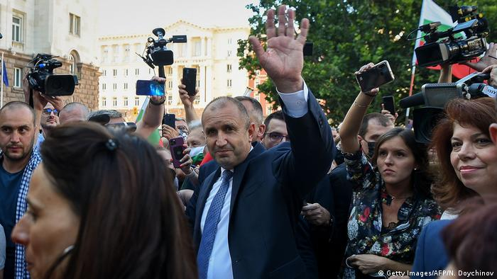 President Rumen Radev waves at the camera as he is surrounded by supporters