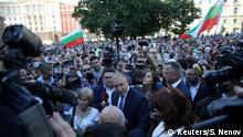 Bulgarian President Rumen Radev (C) talks to supporters at a demonstration after prosecutors raided Bulgarian president's offices as part of investigations, in Sofia, Bulgaria, July 9, 2020. REUTERS/Stoyan Nenov