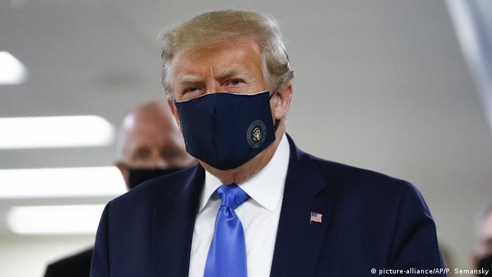 US President Donald Trump wearing a face mask in public for the first time