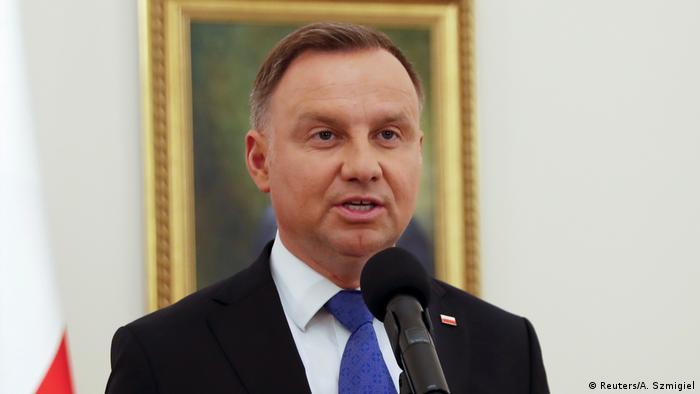 Newly reelected President Adrzej Duda speaks to the press