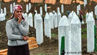 Woman stands at Srebrenica monument