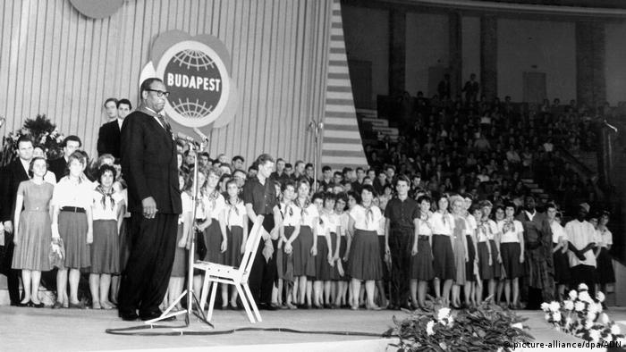 Paul Robeson stands on a stage in the former GDR during an address