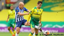 Soccer Football - Premier League - Norwich City v Brighton & Hove Albion - Carrow Road, Norwich, Britain - July 4, 2020 Brighton & Hove Albion's Aaron Mooy in action with Norwich City's Kenny McLean, as play resumes behind closed doors following the outbreak of the coronavirus disease (COVID-19) Richard Heathcote/Pool via REUTERS EDITORIAL USE ONLY. No use with unauthorized audio, video, data, fixture lists, club/league logos or live services. Online in-match use limited to 75 images, no video emulation. No use in betting, games or single club/league/player publications. Please contact your account representative for further details. TPX IMAGES OF THE DAY