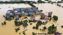 An aerial view shows buildings and farmlands partially submerged in floodwaters following heavy rainfall in Duchang county, Jiangxi province, China July 8, 2020. China Daily via REUTERS ATTENTION EDITORS - THIS IMAGE WAS PROVIDED BY A THIRD PARTY. CHINA OUT.