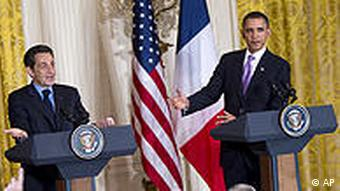 French President Nicolas Sarkozy, left, gestures during a news conference with President Barack Obama in the East Room of the White House on Tuesday, March 30, 2010 in Washington. (AP Photo/Evan Vucci)