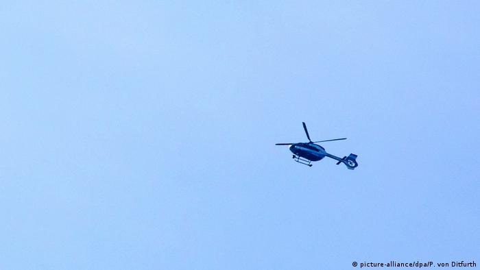 A police helicoptor searching for the armed man