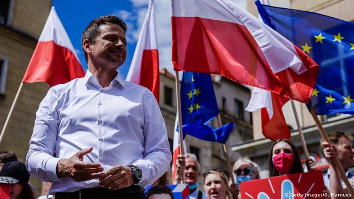 Mayor of Warsaw Rafal Trzaskowski appears at an election rally in front of fans with flags
