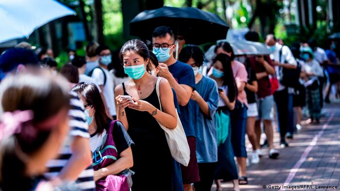 Hong Kongers line up to vote in a primary election