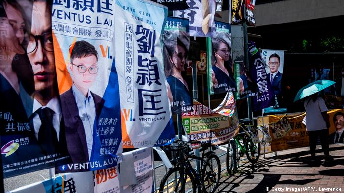Campaign flags are seen tied to a railing during primary elections in Hong Kong