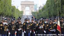 Soldiers in masks at Bastille Day celebration (Getty Images/AFP/L. Marin)
