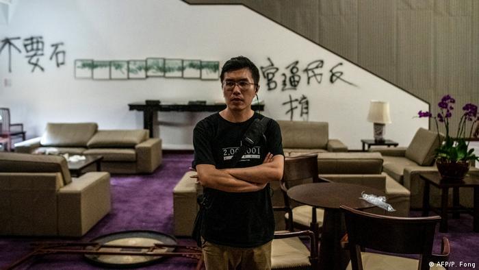 Au Nok Hin stands inside a room in Legislative Council in Hong Kong
