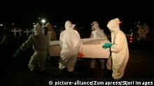 June 19, 2020, Surabaya, East Java, Indonesia: SURABAYA, INDONESIA - JUNE 19, 2020 : Indonesia medical officers performed the funeral process for corpses affected by coronavirus Covid-19 in Surabaya, East Java province, Indonesia on June 19, 2020. (Credit Image: © Sijori Images via ZUMA Wire  