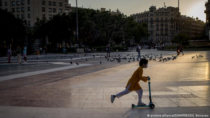 Child rides a scooter, Catalunya square, Barcelona