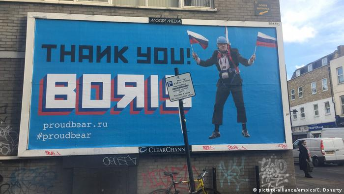 A billboard showing Boris Johnson and his ties to Russia