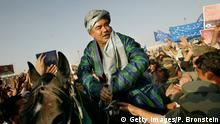 ***2004*** KABUL,AFGHANISTAN - OCTOBER 6: Presidential candidate General Abdul Rashid Dostum sits on a horse during his final campaign rally October 6,2004 at Kabul stadium in Kabul, Afghanistan. Afghans will participate for the first time in direct presidential elections on October 9. (Photo by Paula Bronstein/Getty Images)