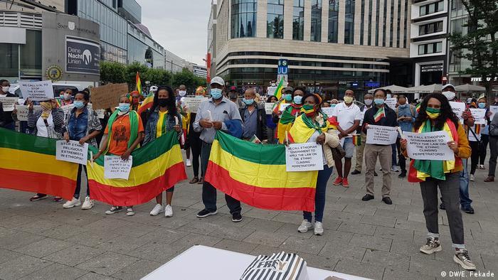 Members of Germany's Ethiopian diaspora hold Ethiopian flags in Frankfurt