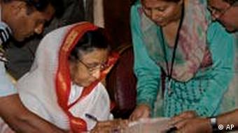 Indian President Pratibha Patil signs after being counted for the census, which began on April 1, 2010