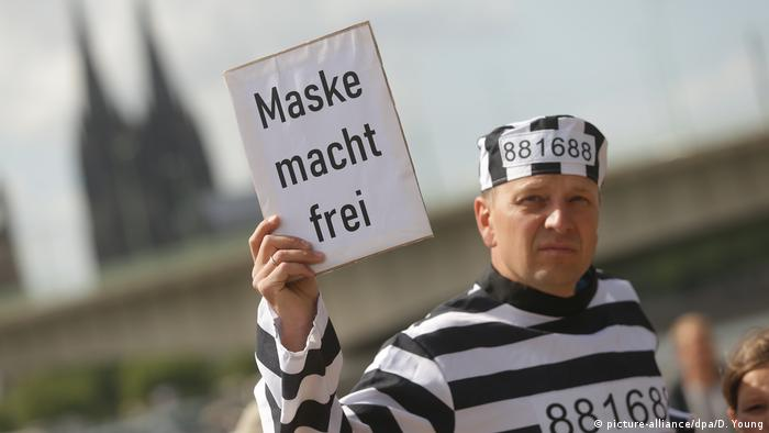 Demonstrator in Cologne dressed as concentration camp inmate