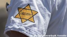 Star of David on a sleeve reading not vaccinated