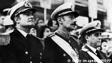 General Orlando Ramon Agosti (R), Commandant of Argentinian Air Force, Lieutenant General Jorge Rafael Videla (C), President of Argentina, and Admiral Emilio Massera (L) attend an official ceremony, Argentina, 1977. After leading the military coup that deposed Peron on 24 March 1976, Videla became President as head of three-man military junta including General Agosti and Admiral Massera. Videla retired in 1981 and was succeeded by General Roberto Viola. In 1985, Videla was convicted of murder and sentenced to life imprisonment in 1985, but was pardoned by President Menem in 1990. American sources reported 6,000 capital executions and from 12,000 to 17,000 people jailed since March 1976. (Photo credit should read OFF/AFP via Getty Images)