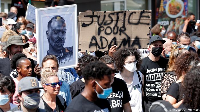 eople wearing protective face masks attend a march in memory of Adama Traore, a 24-year-old Black Frenchman who died in a 2016 police operation