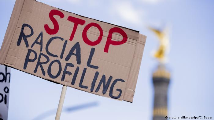protest sign reading 'stop racial profiling'
