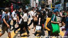 Hongkong | Coronavirus | Passanten mit Mundschutz