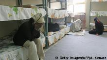 Tehran, IRAN: TO GO WITH AFP STORY IRAN-JUSTICE-PRISON-SOCIT BY PIERRE CELERIER Iranian women inmates sit at their cell in the infamous Evin jail, north of Tehran, 13 June 2006. AFP PHOTO/ATTA KENARE (Photo credit should read ATTA KENARE/AFP via Getty Images)