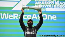 Formula One F1 - Hungarian Grand Prix - Hungaroring, Budapest, Hungary - July 19, 2020 Mercedes' Lewis Hamilton celebrates winning the race on the podium with the trophy Joe Klamar/Pool via REUTERS
