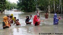 Flood-affected people are seen on water as they wait for a boat to cross a stream in Jamalpur, Bangladesh, July 18, 2020. REUTERS/Mohammad Ponir Hossain
