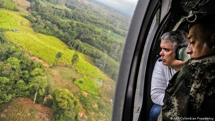Colombian President Ivan Duque flies in a helicopter over coca plantations