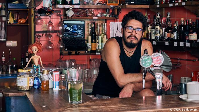 Bar owner Miki Karpat in his Budapest establishment