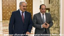 FILE - In this May 9, 2019 file photo, provided by Egypt's presidency media office, Egyptian President Abdel-Fattah el-Sissi, right, walks with military commander Khalifa Hifter, the head of the self-styled Libyan National Army, in Cairo, Egypt. The Egyptian Parliament is likely to vote Monday, July 20, 2020, to authorize the country's president to deploy troops to war-torn Libya if Turkey-backed forces allied with the U.N.-supported government in Tripoli move to retake the strategic coastal city of Sirte. The country is now split between a government in the east, allied with Hifter, and one in Tripoli, in the west, supported by the United Nations. Along with Egypt, Hifter is also backed by the United Arab Emirates and Russia, while the in addition to Turkey, the Tripoli forces are aided by Qatar and Italy. (Egyptian Presidency Media office via AP, File) |