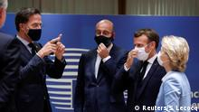 Dutch Prime Minister Mark Rutte, European Council President Charles Michel, French President Emmanuel Macron and European Commission President Ursula von der Leyen interact while wearing face masks during the last roundtable discussion following a four-day European summit at the European Council in Brussels, Belgium, July 21, 2020. Stephanie Lecocq/Pool via REUTERS