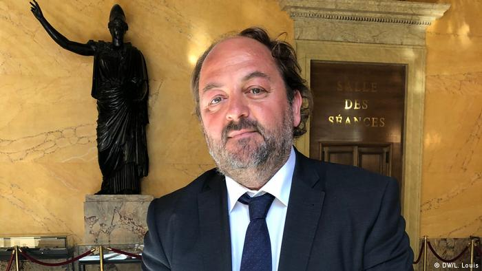 French politician Raphael Gauvin wears a shirt and tie and looks into the camera