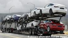 FILE - In this May 12, 2020 file photo, a truck loaded with Tesla cars departs the Tesla plant in Fremont, Calif. Tesla has posted three straight profitable quarters, opened a factory in China and rolled out the Model Y small SUV. Yet ahead of second-quarter results on Wednesday, July 21, analysts are beginning to question whether the run will last. (AP Photo/Ben Margot, File) |